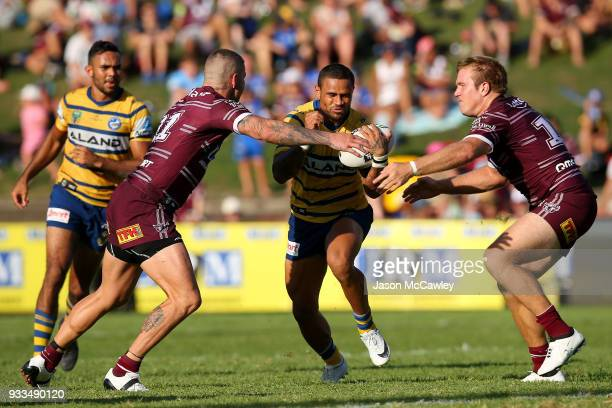 Josh Hoffman of the Eels is tackled by Joel Thompson and Jake Trbojevic of the Sea Eagles during the round two NRL match between the Manly Sea Eagles...