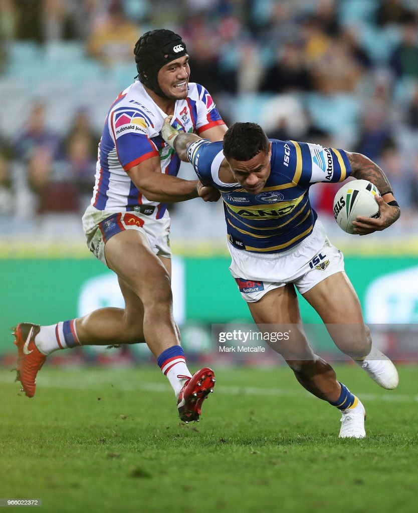Josh Hoffman of the Eels is tackled by Sione MataÕutia of the Knights during the round 13 NRL match between the Parramatta Eels and the Newcastle Knights at ANZ Stadium on June 2, 2018 in Sydney, Australia.