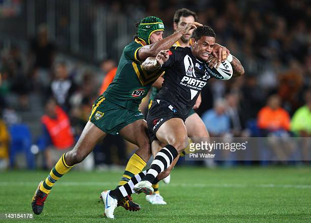 Josh Hoffman of the Kiwi's is tackled by Johnathan Thurston of the Kangaroos during the ANZAC Test match between the New Zealand Kiwis and the...