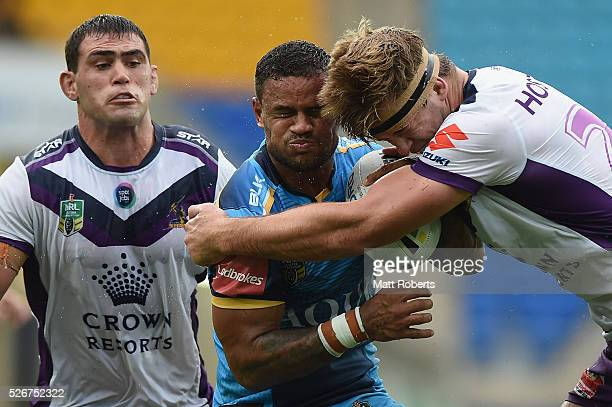 Josh Hoffman of the Titans is tackled during the round nine NRL match between the Gold Coast Titans and the Melbourne Storm on May 1 2016 in Gold...