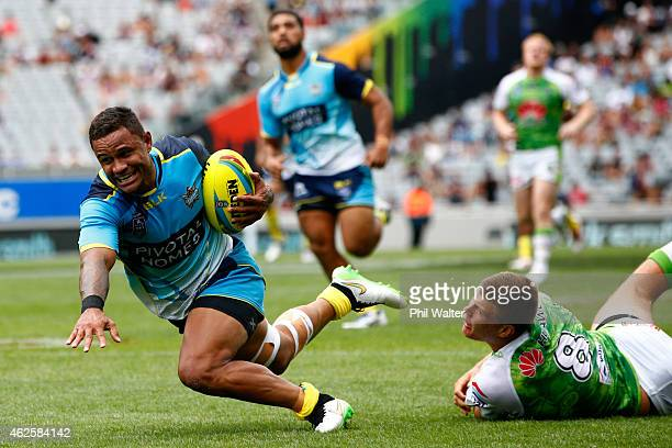 Josh Hoffman of the Titans scores a try during the match between the Titans and the Raiders in the 2015 Auckland Nines at Eden Park on February 1,...