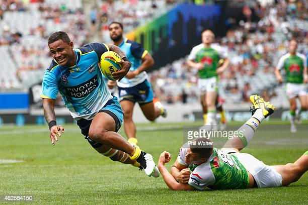 Josh Hoffman of the Titans scores a try during the match between the Titans and the Raiders in the 2015 Auckland Nines at Eden Park on February 1...