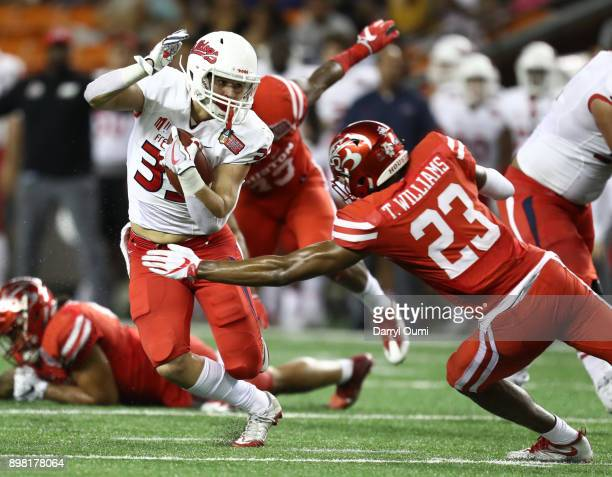 Josh Hokit of the Fresno State Bulldogs looks to avoid being tackled by Terrell Williams of the Houston Cougars during the third quarter of the...