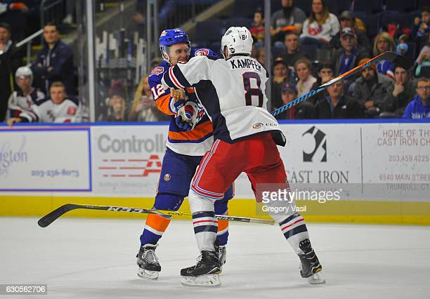 Josh Holmstrom of the Bridgeport Sound Tigers and Steven Kampfer of the Hartford Wolf Pack fight at the Webster Bank Arena on December 26 2016 in...
