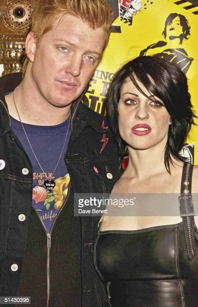 Josh Homme and Brody Dalle attend the 2004 NME Magazine Awards at The Hammersmith Palais on February 12 2004 in London