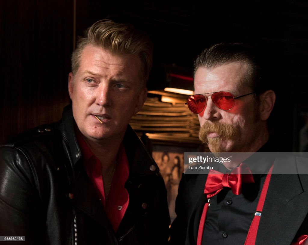 Josh Homme (L) and Jesse Hughes arrive for the premiere of HBO's 'Eagles Of Death Metal: Nos Amis (Our Friends)' at Avalon Hollywood on February 2, 2017 in Los Angeles, California.