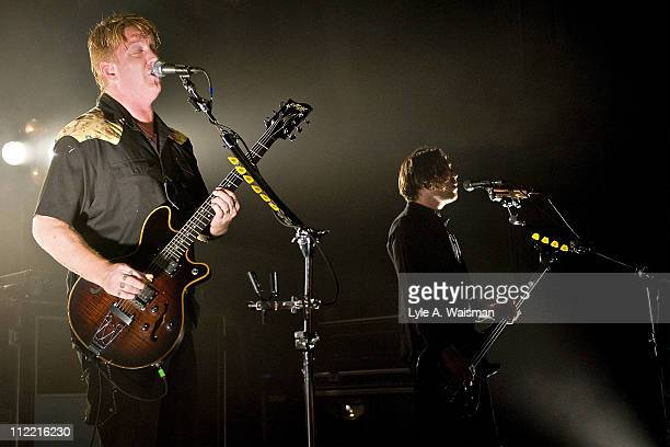 Josh Homme and Michael Shuman of Queens of the Stone Age perform at the Riviera Theatre on April 1, 2011 in Chicago, Illinois.