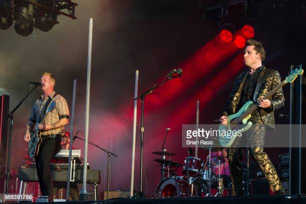 Josh Homme and Michael Shuman of Queens of the Stone Age perform live on stage at Finsbury Park on June 30 2018 in London England