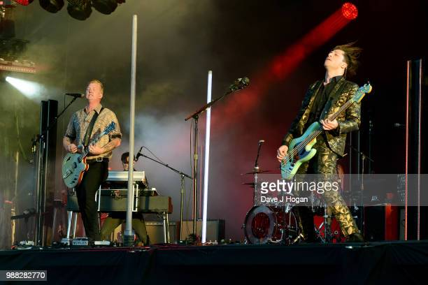 Josh Homme and Michael Shuman of Queens of the Stone Age perform on stage at Finsbury Park on June 30 2018 in London England