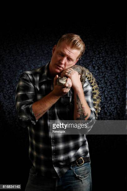 DARWIN NT Josh Homme of Queens of the Stone Age holds a crocodile during a photo shoot in Darwin Northern Territory