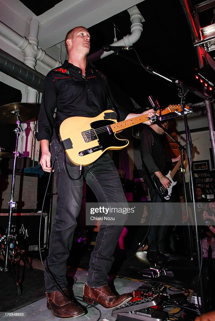Josh Homme of Queens of the Stone Age performs at Rough Trade East on June 11, 2013 in London, England.