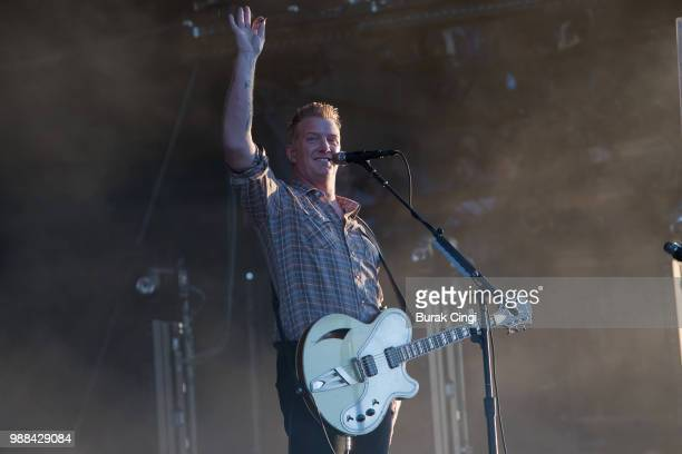 Josh Homme of Queens of the Stone Age performs at the Queens of the Stone Age and Friends show at Finsbury Park on June 30 2018 in London England