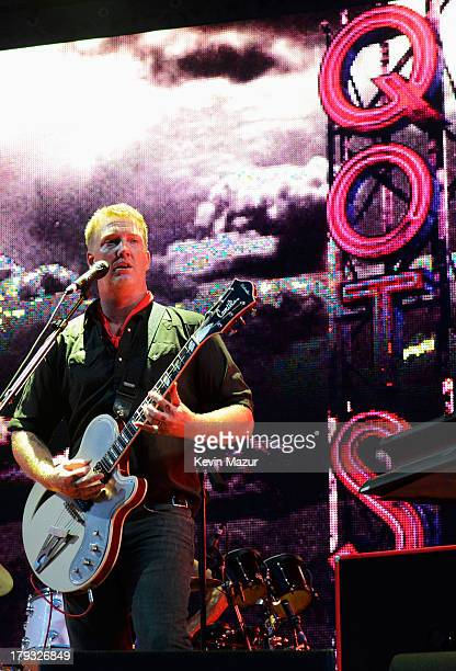 Josh Homme of Queens of the Stone Age performs during the 2013 Budweiser Made In America Festival at Benjamin Franklin Parkway on September 1 2013 in...