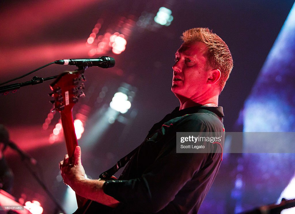 Josh Homme of Queens of the Stone Age performs in concert at The Fillmore on September 12, 2013 in Detroit, Michigan.