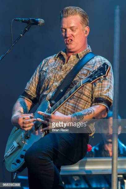 Josh Homme of Queens of the Stone Age performs live on stage at Finsbury Park on June 30 2018 in London England