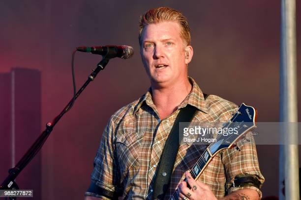 Josh Homme of Queens of the Stone Age performs on stage at Finsbury Park on June 30 2018 in London England