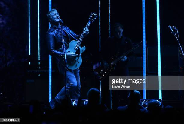 Josh Homme of Queens of the Stone Age performs onstage during KROQ Almost Acoustic Christmas 2017 at The Forum on December 9 2017 in Inglewood...