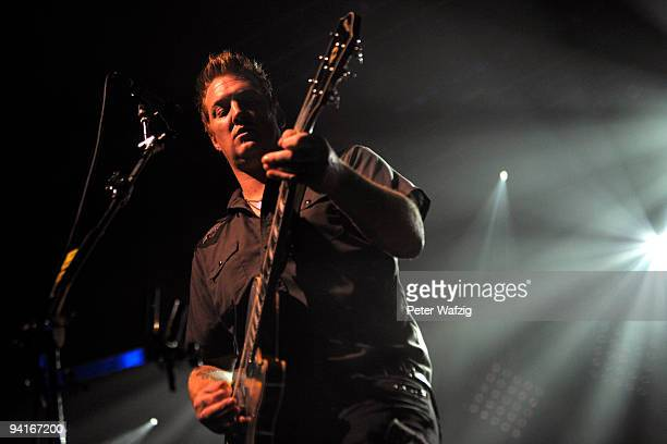 Josh Homme of Them Crooked Vultures performs on stage at the Palladium on December 08 2009 in Cologne Germany