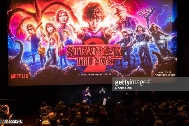 """Josh Horowitz and Millie Bobby Brown attend a """"Stranger Things Season 2"""" screening at AMC Lincoln Square Theater on August 21, 2018 in New York City."""