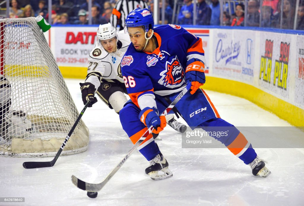 Josh Ho-Sang #26 of the Bridgeport Sound Tigers brings the puck around the goal during a game against the Hershey Bears at the Webster Bank Arena on February 19, 2017 in Bridgeport, Connecticut.
