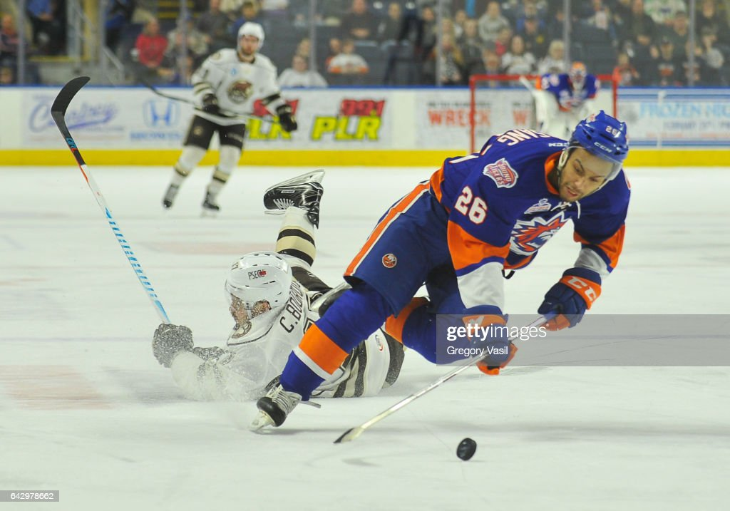 Josh Ho-Sang #26 of the Bridgeport Sound Tigers is tripped during a game against the Hershey Bears at the Webster Bank Arena on February 19, 2017 in Bridgeport, Connecticut.
