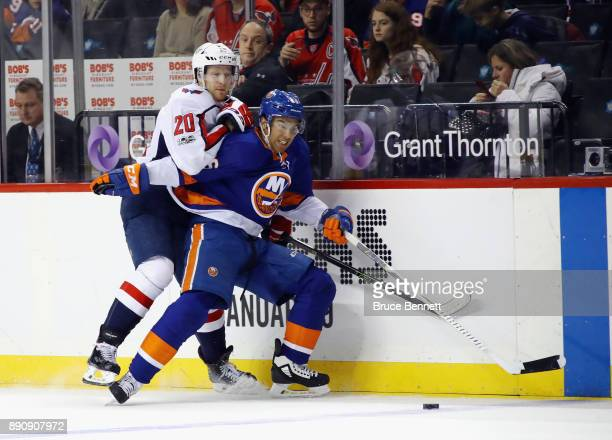 Josh HoSang of the New York Islanders is checked by Lars Eller of the Washington Capitals at the Barclays Center on December 11 2017 in the Brooklyn...