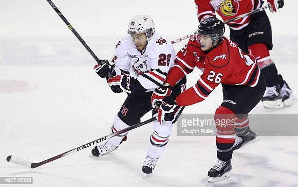 Josh HoSang of the Niagara IceDogs gets past Jacob Busch of the Owen Sound Attack during an OHL game between the Owen Sound Attack and the Niagara...