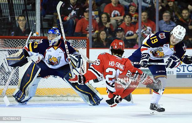 Josh HoSang of the Niagara IceDogs is checked by Rasmus Andersson of the Barrie Colts during the second period against in Game Three of the 2016 OHL...