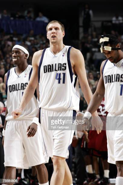 Josh Howard Dirk Nowitzki and Greg Buckner of the Dallas Mavericks walk across the court during the game against the Miami Heat on February 22 2007...