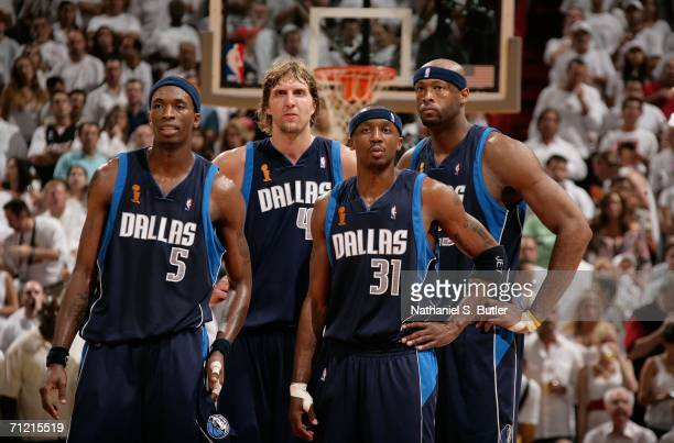 Josh Howard Dirk Nowitzki Jason Terry and Erick Dampier of the Dallas Mavericks stand on court against the Miami Heat during Game Four of the 2006...