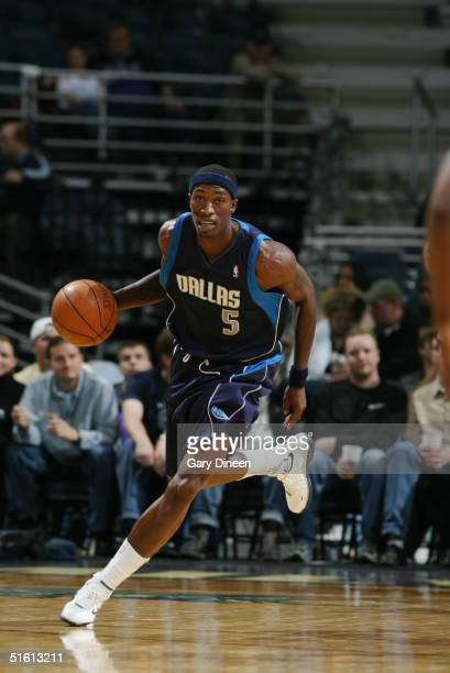 Josh Howard of the Dallas Mavericks drives against the Milwaukee Bucks during the preseason game at Bradley Center on October 23 2004 in Milwaukee...