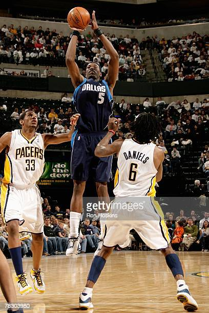 Josh Howard of the Dallas Mavericks puts a shot up over Marquis Daniels and Danny Granger of the Indiana Pacers during the game on November 23 2007...