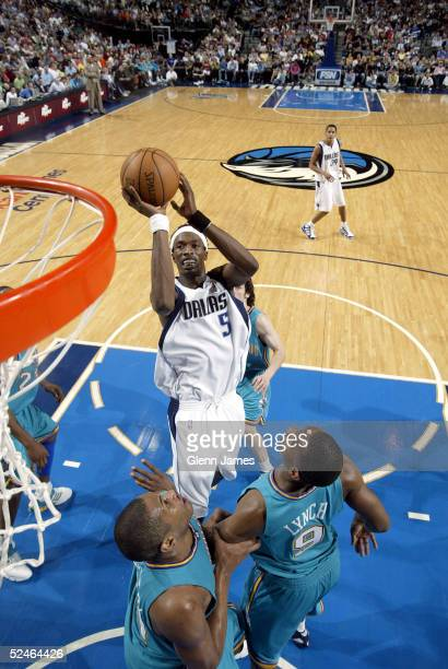 Josh Howard of the Dallas Mavericks shoots a jumper against George Lynch of the New Orleans Hornets on March 21 2005 at the American Airlines Center...
