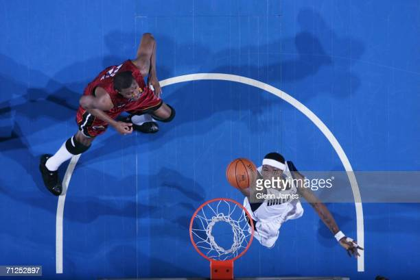 Josh Howard of the Dallas Mavericks shoots against James Posey of the Miami Heat during Game Six of the 2006 NBA Finals on June 20 2006 at the...