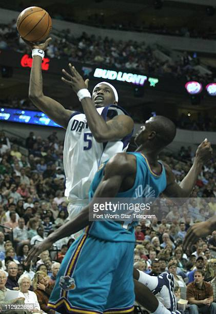 Josh Howard of the Dallas Mavericks shoots over the New Orleans/Oklahoma City Hornets' Linton Johnson. The Mavericks defeated the Hornets, 101-77, at...