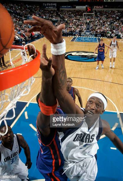 Josh Howard of the Dallas Mavericks tips in the ball against Jackie Butler of the New York Knicks at the American Airlines Center in Dallas Texas on...