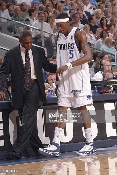 Josh Howard of the Dallas Mavericks walks off of the court with head coach Avery Johnson after Howard rolled his ankle in game one of the Western...