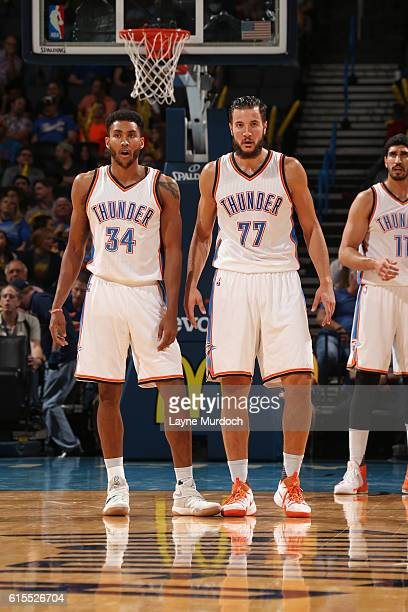 Josh Huestis and Joffrey Lauvergne of the Oklahoma City Thunder look on during a preseason game against the Denver Nuggets on October 18 2016 at...