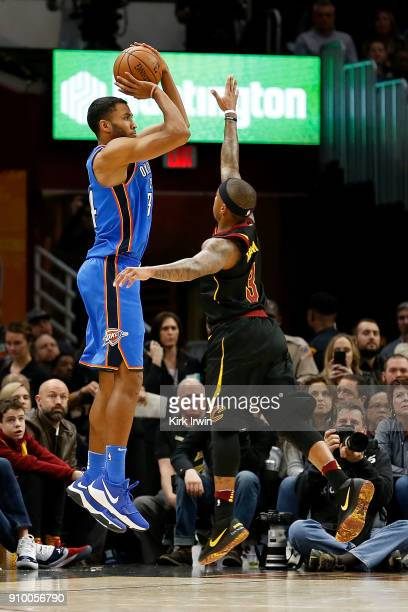 Josh Huestis of the Oklahoma City Thunder attempts to shoot the ball over the defense of Isaiah Thomas of the Cleveland Cavaliers during the game at...