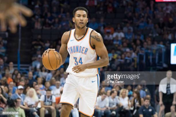 Josh Huestis of the Oklahoma City Thunder brings the ball up court against the Melbourne United during the first half of a NBA preseason game at the...