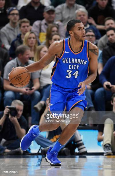 Josh Huestis of the Oklahoma City Thunder brings the ball up court during their against the Utah Jazz game at Vivint Smart Home Arena on December 23...