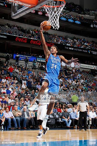 Josh Huestis of the Oklahoma City Thunder drives to the basket against the Dallas Mavericks on October 11 2016 at the American Airlines Center in...