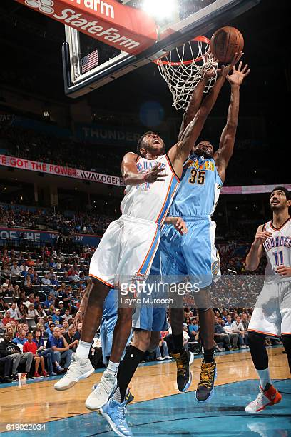 Josh Huestis of the Oklahoma City Thunder drives to the basket against the Denver Nuggets during an NBA preseason game on October 18 2016 at...