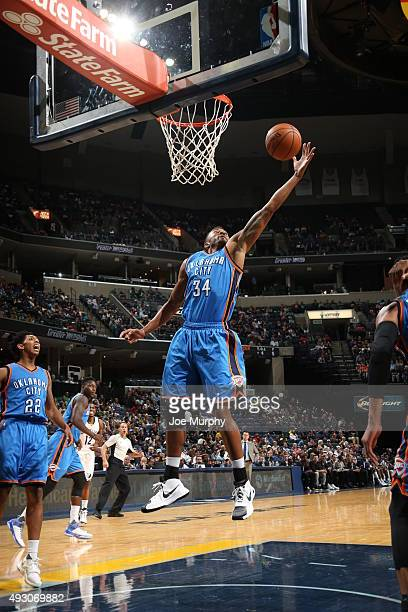 Josh Huestis of the Oklahoma City Thunder goes up for a rebound against the Memphis Grizzlies during a preseason game on October 16 2015 at...
