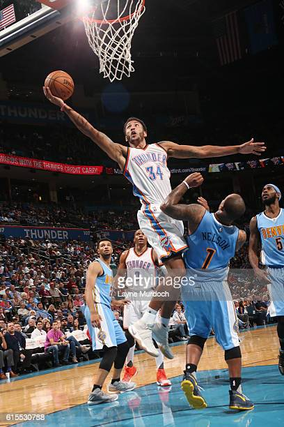 Josh Huestis of the Oklahoma City Thunder goes up for a shot during a preseason game against the Denver Nuggets on October 18 2016 at Chesapeake...