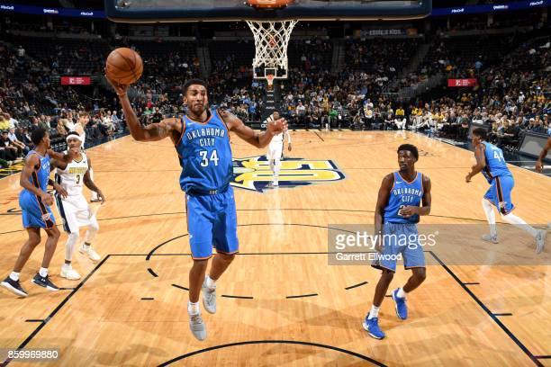 Josh Huestis of the Oklahoma City Thunder grabs the rebound against the Denver Nuggets on October 10 2017 at the Pepsi Center in Denver Colorado NOTE...