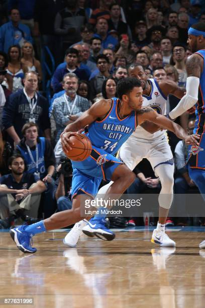 Josh Huestis of the Oklahoma City Thunder handles the ball against the Golden State Warriors on November 22 2017 at Chesapeake Energy Arena in...