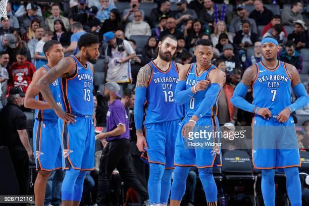 Josh Huestis Paul George Steven Adams Russell Westbrook and Carmelo Anthony of the Oklahoma City Thunder face the Sacramento Kings on February 22...