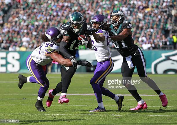 Josh Huff of the Philadelphia Eagles attempts to run between Eric Kendricks and Trae Waynes of the Minnesota Vikings after making a catch during the...
