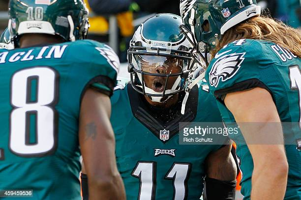 Josh Huff of the Philadelphia Eagles celebrates his touchdown with teammates Jeremy Maclin and Riley Cooper in the first quarter against the...